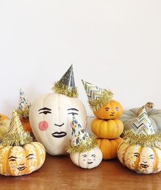 Painted pumpkin faces inspired by my little Belleville.