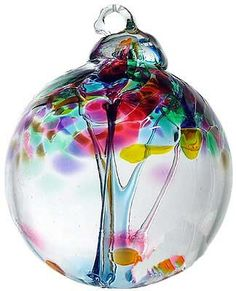 """Kitras Art Glass still honors the old world tradition of glass blowing with studios in Canada. The 2"""" Blossom Ball ornament is typical of their design, featuring an inside trunk with threads blossomin"""