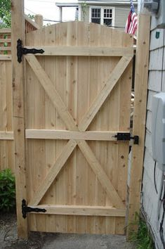 Charming Fence Gate Designs To Take Into Protect Your Home. Naturally Fence Gate Design Featuring Classic Solid Wood Fence Gate And Black Steel Fence Gate Hinges And Black Stainless Steel Door Lock.
