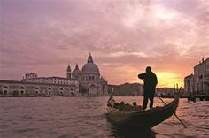 Venice - I really want to go to Venice during the Masquerade Ball.  I want to experience Venice sunrise, as well as Venice sunsets.  I want to take a Mosaic  Art class while in Venice and stroll the local markets.  I've never been there, but I imagine it is the most beautiful city in the world.