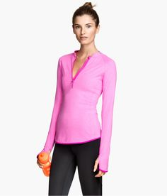 Pink fitted running top with fast-drying fabric, long sleeves with thumbholes, and reflective trim. | H&M Sport
