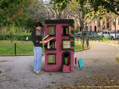 "Artist Leon Reid IV and film producer Julia Marchesi have teamed up to realize their dream of kid-sized Brooklyn brownstones that would allow passersby the opportunity to leave books for others. They are calling it ""The Hundred Story House."""