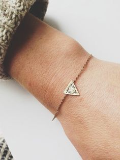 Hand forged brass triangle, with unique symmetrical pattern stamped onto its face, silver soldered to a delicate antique brass chain with a handmade 14k gold filled clasp.