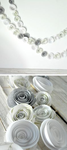White & Silver Paper Flower Garland by LIlle Syster on Scoutmob Shoppe. Would make a gorgeous wintry holiday decoration. We'd build a whole table around this beauty!