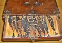 Very Unusual Antique Japanese Fisherman's Tackle Box  Fabulous and rare Showa Period c.1940 fisherman's tackle box full of hand painted wood lures with bronze hooks. The lures were used for squid and painted to mimic the colors of the squid. There are 31 hand-painted ones and 33 unpainted lures. They come in a handsome Japanese elm and cedar lacquered box with drawers and beautiful copper metal fittings.