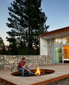 Hole in deck for fire pit and bench; David Coleman Architecture