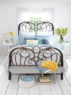 Love the pops of yellow! Blue and yellow are one of my favorite color combos. Plus, you gotta love that whimsical bed! Looks fab with the beachy vibe of the room.