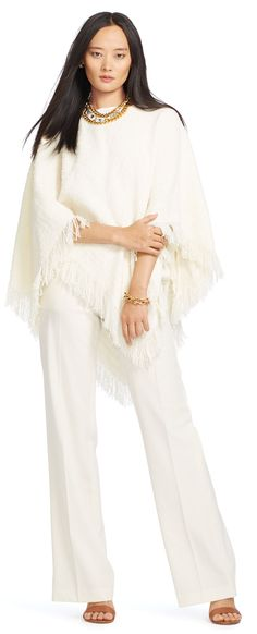 This textural cream bouclé poncho from Lauren Ralph Lauren is finished with fringed trim to enhance its romantic rusticity. Accent its feminine bateau neckline with a statement necklace.
