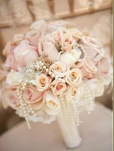 .USE CREME, LIGHT PINK, AND PALE YELLOW ROSES WITH PEARLS