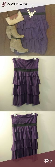Express Strapless Ruffle Dress The Express strapless purple ruffle dress is slightly gathered at the sides and can be dressed up or dressed down. Beautifully tiered elastic black band under bust and elastic at top give us a flattering and clothes fit for all body types. Express Dresses Strapless