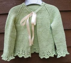 Pevensey is a summer cardigan for a little girl, sized from 18-24 months to 5 years. The plain stocking stitch is made beautiful by the addition of lace at the hem and cuffs, and a pretty bow or button as fastening. It is worked in one piece from the bottom up with minimal finishing required. The double-knitting weight yarn means it knits up quickly.Pevensey Bay is a seaside resort on the Sussex coast.