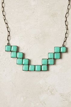 Teeny turquoise tiles by Jane Diaz, who has collaborated with Nepalese silversmiths for over twenty years.