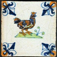 Antique Delft tile with hen, 17th century.