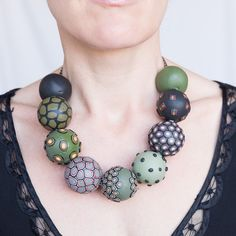 Bold stylish artisan statement necklace of chunky green handmade polymer clay beads - in Mossy Planets on a Sunday