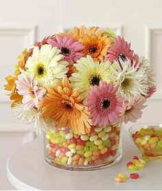 Centerpiece with small jelly beans and gerber daisies