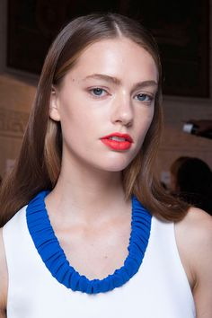 The hair at Victoria Beckham by Redken Global Creative Director, Guido was a sophisticated, simple style full of shine. The orangy-red matte lipstick against dewy 'supermodel skin' came courtesy of lead makeup artist Pat McGrath. Hot! - Cosmopolitan.co.uk
