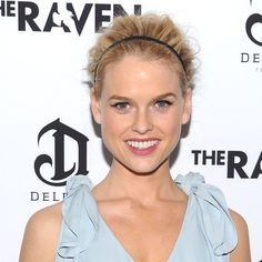 Hair styled close to the head in front of a headband and with volume at the crown gives Alice Eve an edgier take on a classic style. Cranford suggests that a French twist in the back would be a perfect complement.