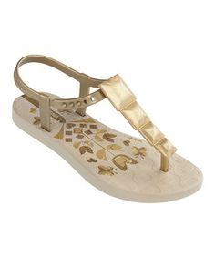 Look at this #zulilyfind! Beige & Gold Maya T-Strap Sandal - Kids by Ipanema #zulilyfinds
