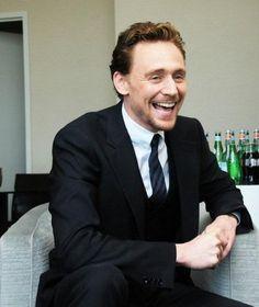 Smiles. Tom Hiddleston