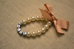 CUSTOM NAME - Adorable Pearl Name Bracelet with Satin Bow - Ivory pearls, Tan ribbon on Etsy, $10.00