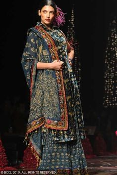 tarun tahiliani. love the use of ethnic hand blocked prints for couture.