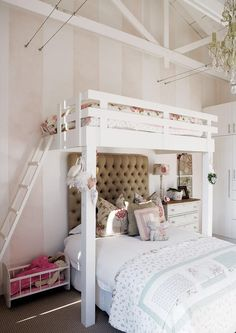 White bunk-bedded room for girls. Lovely design for the top-bunk, great for sleepovers... this might cause a fight about who sleeps at the top but nice idea to solve our space problem