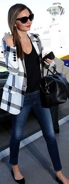 Who made  Miranda Kerr's black leather handbag, white plaid blazer, black ballet flat shoes, skinny jeans and cat eye sunglasses that she wore at LAX airport?