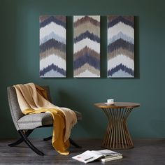Alpine is a triptych set that features a watercolor chevron pattern with different hues of blues, grey, and a crisp white. This three piece set is printed on canvas and lightly gel coated for texture. Alpine is a simple yet charming piece of art that will look great over a sofa.