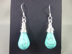 Turquoise drops wrapped with a non-tarnish silver wire and finished with sterling silver earwires. Tarnished Silver, Sterling Silver, Wire Wrapped Earrings, Drop Earrings, Wire Wrapping, Turquoise, Jewelry, Jewlery, Jewels