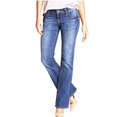 Michael Kors Jeans Size 6. Cotton / spandex. Medium wash. Bootcut style. Gold circle stud pocket detail. Length 40, inseam 32, waist flat 16. Michael Kors Jeans Boot Cut