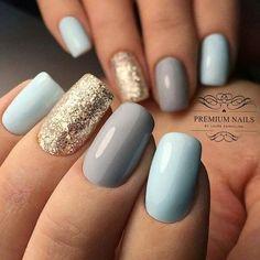 Light blue, light grey with gold glitter nails. #GlitterNails