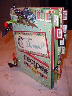 recipe scrapbook and the front is a clip board. cool idea.