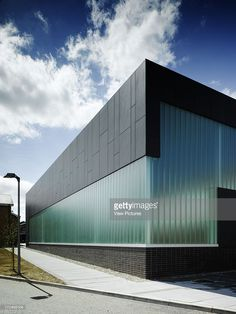 View of multipurpose hall showing fibrecement cladding, reglit glass and path in. Metal Building Homes, Building Facade, Building Design, Factory Architecture, Facade Architecture, Industrial Architecture, Contemporary Architecture, Facade Design, Exterior Design
