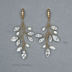 Check our Ready to Ship Pieces with great Discount !!! https://www.etsy.com/shop/adriajewelry?ref=hdr_shop_menu&section_id=20069708 ~~~~~~~~~~~~~~~~~~~~~~~~~~~~~~~~~~~~~~~~~~~~~~~~~~~~~~~~~~~~~~  Earrings feature white fresh water pearls, very sparkling high quality Swarovski Rhinestones and stunning cubic zirconia embellished ear wires. Sizes: full length approx 5cm . very light weight. Color: Available in Gold and Silver. Please choose a color when you pla...