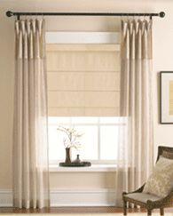 I love the idea of the DIY Roman Shade in neutral with a matching sheer curtain.  This is elegant and could allow for some great lighting options.