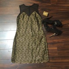 """Black and gold dress Fits size 2/4. 33"""" total length. Hidden zipper down back. Beautiful rose design thought out the dress. 97% polyester, 3% spandex. Dress the population Dresses"""