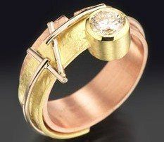 Contemporary Engagement Off-Set Diamond 6 in textured multicolor golds, snug wedding band available. Options include colors of golds and using a gemstone instead of a diamond. Starting at $2795.