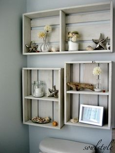 Hang some DIY crates on the area over the toilet to add some decor. The dried beach dahlias in tiny bubble vases, mason jars filled with candles & bath salts, some driftwood, and a few starfish & shells make your bathroom super fantastic. http://hative.com/over-the-toilet-storage-ideas-for-extra-space/: