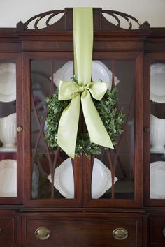 Elegant Holiday Wreath ... Ohhhhh I LOVE this idea & don't know WHY I NEVER thought of this before!!! I'm going to have to do just this with my breakfront!