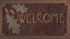Oak & acorn Welcome sign with green and chocolate glaze from Fay Jones Day Tile