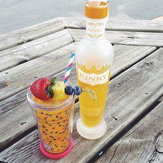 Delish! KINKY Gold with lemon-lime soda and fruit garnishes.