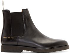 Brushed leather chelsea boots in black. Elasticized gussets at sides. Grosgrain pull-loop in off-white at heel collar. Gold series stamp at outer heel. Crepe rubber sole in dark brown. Tonal stitching.