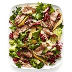 """Warm chicory steak salad with agrodolce dressing. An Italian sweet-and-sour sauce made with vinegar, honey, and raisins--agrodolce, literally """"sour/sweet""""--softens the bitterness of radicchio and escarole. Serve this salad right away, while it's crisp. Salad Recipes For Dinner, Healthy Salad Recipes, Vegetarian Recipes, Healthy Meals, Steak Recipes, Cooking Recipes, Drink Recipes, Suddenly Salad, Salads Up"""