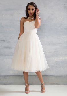 You and this midi dress by Chi Chi London are a match so great, it could be fate! Pair it with the most magical of occasions and you'll find its subtle blush hue, sweetheart neckline, white crocheted bodice, and voluminous tulle skirt is even more sublime than imagined, making a sweet statement on your special day.