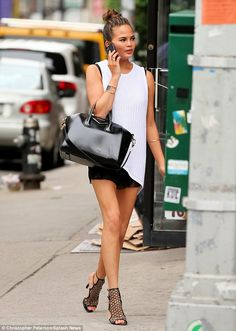 Accessories do count: The 28-year-old model sported a fashionable Givenchy handbag as she ...