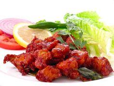 Chicken 65 ( चिकन When it comes to savory chicken dishes, Chicken 65 is deep-fried chicken in a piquant sauce. Veg Recipes, Spicy Recipes, Indian Food Recipes, Vegetarian Recipes, Cooking Recipes, Andhra Recipes, Delicious Recipes, Easy Recipes, Pollo Tandoori