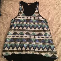 Sequined tank top Sequenced tank top in a great condition. Barely worn. Tops Tank Tops