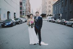 Blush, hot pink, and white garden rose and peony bouquet with ferns Bohemian Bride in a Carol Hannah bustier strapless two piece gown Modern Stylish Jersey City Winter Wedding at Parlay Studios NYC Brooklyn photographer Chellise Michael Photography Ted Baker Black Suit