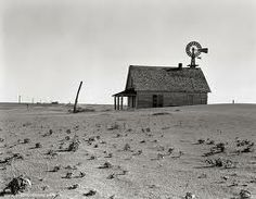 "Source: Photograph 1932 Normally farmers were safe from the effects of a depression, but this time not. At this time it was not only the Great Depression which hit the farmers also strong wind came up and destroyed their Land, the first time 1932.The area were the storms toke place was called ""Dust Bowl"". The area became a desert and the farmers had to live their houses ."