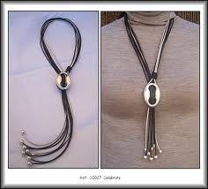 collar cuero pendiente